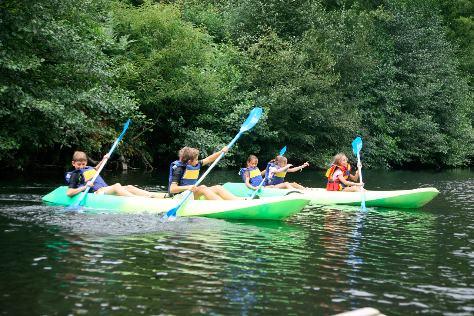 children canoeing in the river